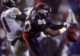 EPS014 - Denver Broncos wide reciever Rod Smith can't hold onto the ball being defended by ...