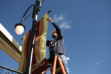 James Williams (cq) puts a banner on a pole on Main Street  in Southlands, October 19, 2006 in...