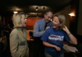Gubernatorial candidate Bob Beauprez jokes while autographing a campaign t-shirt for Lynn Waring,...