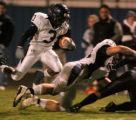 Columbine running back Orenzo Davis, #3, jumps over teammate Ryan Miller, #73 during game action...