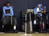 New teammates Carmelo Anthony (left) and Allen Iverson (right) share a laugh while riding...