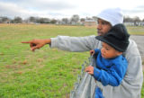 On Thursday afternoon Jan. 4, 2007, Darrell Mayes shows his son Anthony, 2, the football field...