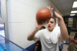 Brandon Sanchez, 13, (cq), takes a shot at the hoop in mini basketball. One of the games in the...