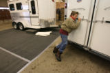 John Murdock, (cq), 13, pushes with all his might, as his family moves a demonstration trailer...