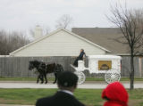 [JPM0302] The casket of Denver Broncos cornerback Darrent Williams ride in a horse-drawn funeral...