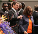 [JPM0859] Rosalind Williams, right, smiles after she joined Denver Broncos safety John Lynch,...