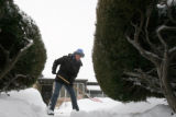 (DLM0211) -   Teri Anderson clears the walkway of an elderly neighbor in Denver, Colo., Sunday...