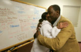 Toni Brooks, left, the mother of Derrek Ward, a Montbello teen killed in a drive-by in December,...