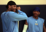 New teammates Carmelo Anthony (left) and Allen Iverson (right) wind down after Denver Nuggets...
