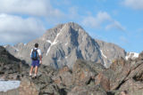 Dave Williams takes a break from hiking Notch Mountain to take in the view of Mount of the Holy...