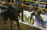 MJM771 Cesar Betancourt is thrown into a wall as he competes in the Mexican Rodeo Extravaganza at...