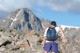 Dave Williams hikes Notch Mountain while taking in a spectacular view of the Mount of the Holy...