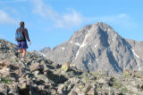Dave Williams climbs Notch Mountain with the Mount of the Holy Cross looming in the background.