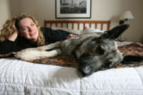 (DLM1120) -  Dorothy Yanchak and her dog Rin Tin Tin X rest at their hotel room in downtown...