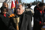 Mayor David Casiano, (cq), Parker, Colo., holds the torch being passed from city to city beginning...