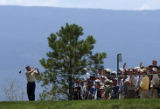(Castle Rock, Colo., August 5, 2004) Greg Norman tees off on the 6th hole of the first round of...