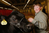 Brock May, from Mineral Point, Wisconsin, with the Reserve Grand Champion Market Steer. (STEVE...