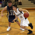 (DLM1759) -  Monarch High School senior Brooks Bajcar, #10, drives to the basket past Legacy High...
