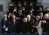 MJM1182 Former Governor Bill Owens waves to the crowd as his wife Frances Owens shakes hands with...