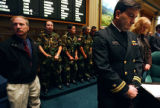 Colorado State Senator Brandon Shaffer (right in naval uniform), D-Longmont,  stands quietly...
