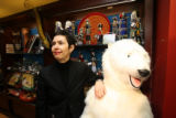 Susan Kirchoff, (cq), Museum Shop Store Manager, at the front entrance with a large stuffed bear....