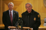 Weld County district attorney Ken Buck, left, and Greeley Police Chief Jerry Garner, right, speak...