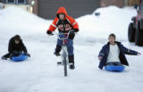Noah Jones (cq), center, 10, tows Derek Knight (cq), right, 13, towards a jump they made in the...