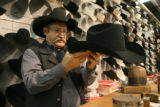 Texan Rick Bishop, cq, owner of Western Tradition in Mabank, Texas, shapes a hat at the National...