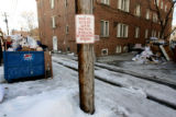 Trash piles up between two apartment buildings in a alley from 10th to11th on the east side of...