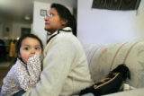 Regina Harris (cq) a single mother of three, holds her youngest daughter Loren 2, in her Lakewood...