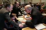 Sen. Mike Kopp (cq), R, (l), talks with Sen. Andy McElhany, R, (r) on the opening day of the...