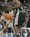 Denver Nuggets forward Eduardo Najera, left, saves the ball from going out of bounds in the second...