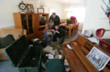 With thier son's personal possessions spread out in the living room, mother Debra Anderson, father...