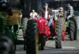Antique tractors with the Rocky Mountain Pullers, join in the National Western Stock Show Parade,...