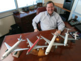 (DLM1369) -  Model planes marking the airlines that Tom Nunn has worked for over his career sit on...