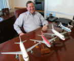 (DLM1353) -  Model planes marking the airlines that Tom Nunn has worked for over his career sit on...