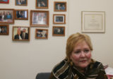 Pat Waak, (cq), in her office filled with personal photos of her with various party people...