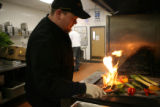 Mitch Cavin, cq, grills vegetables at Epicurean Catering, 6022 South Holly Street, Thursday Jan....