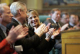 Lt. Governor Barbara O'Brien smiles and applauds as she listens to Governor Bill Ritter talk about...
