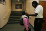 (DLM4066) -  Rev. Leon Kelly talks with student Ajanique Williams in the hall during the Open Door...