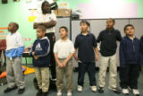 (DLM4073) -  Rev. Leon Kelly watches over some of the boys singing in the second and third grade...