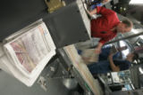 BG0360  Workers adjust the newly formated Rocky Mountain News regional edition during the Rocky's...