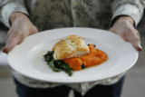 Fresh Hawaiian Opakapaka (pink snapper), with wilted greens and chervil buerre blanc over a bed of...