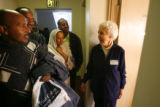 (DLM1059) -  Edna Hollis, 94, right, talks with members of the Medhaneal Ethiopia Orthodox Tewahed...