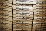 (NYT22) DALLAS -- Jan. 14, 2007 -- TEXAS-PIZZA-FLAP-2 -- Pizza boxes at Pizza Patron in Dallas on...