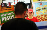 (NYT21) DALLAS -- Jan. 14, 2007 -- TEXAS-PIZZA-FLAP -- Teresa Hernandez taking an order on Friday,...