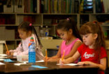(Sheridan, Colo., July 7, 2004)  L to R: First grade students Jennifer Torres, Odalys (cq) Acosta,...