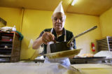 Dino Karas (cq), 65, was born in Greece and has owned the Omonoia Bakery on East Colfax since...