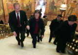 U.S. Sen. Wayne Allard and his wife Joan leave the Rotunda at the State Capitol after he announced...