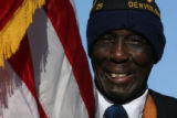 (DLM5943) -  Norman Harris, 88, presents the colors at City Park during the beginning ceremony for...